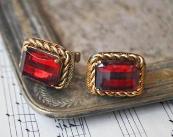 Vintage brass-glass cuff links.