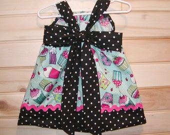 Girls Pillowcase Dress..Blue Cupcake with big bow in back...Custom. sizes 0-6, 6-12, 12-18, 18-24 months, 2T, 3T..Bigger sizes AVAILABLE