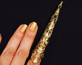 Golden nail gard, claw ring or armor claw ring, made in gold color filigree, it's sizable.