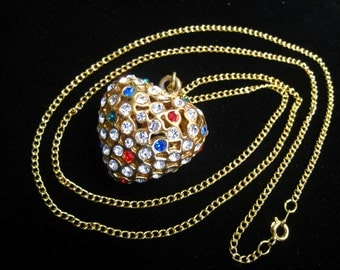 """2-Sided Heart Pendant Necklace. Heavy Puffy Filigree with Inset Rhinestones. Mostly Clear, Some Red, Blue, & Green.  30"""" Long Chain."""