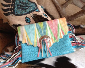 Southwestern pastel print and turquoise faux alligator leather fringe clutch
