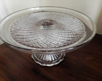 A large sparkly glass pedestal cake stand. Measures 11'5 inches in diameter. Suitable for cake base measuring 10.5 inches