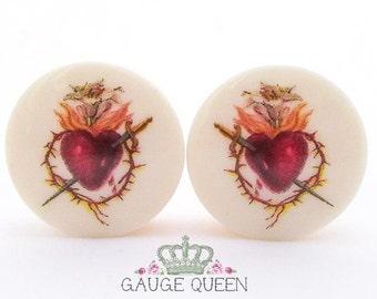 """Sacred Heart Plugs / Gauges. 4g /5mm, 2g /6.5mm, 0g /8mm, 00g /10mm, 1/2"""" /12.5mm, 9/16"""" /14mm, 5/8"""" /16mm, 3/4"""" /19mm, 7/8"""" /22mm, 1"""" /25mm"""