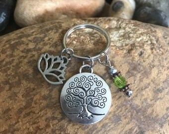 Silver Tree of Life Keychain with a peridot crystal and a lotus charm