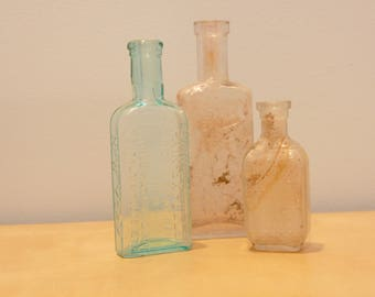 Set of Three Antique Glass Bottles- Sea Glass Colors