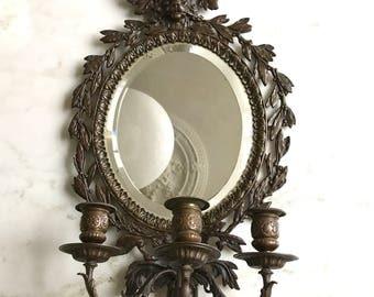 Antique bronze mirror in Empire style
