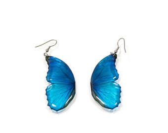 Blue morpho butterfly wing earring looks like real butterfly. Comes in a gift box.
