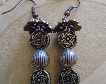 Price Reduced. 4.50 bucks off! Dangle earrings. Silver, black, gold beads and gold swirly bead ends. Unique and handmade dangling earrings.