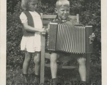 Cute children posing with button accordion antique rppc photo