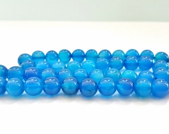 15 Inch Strand of Blue Agate Gemstone Beads.  8mm Round in Size.  48 Gorgeous Beads.  Feminine and Unique!  Lovely Coloring!!
