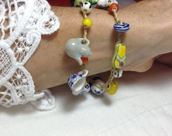 charm bracelet with porcelain and glass beads
