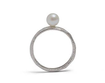Lunar tide pearl stacking ring
