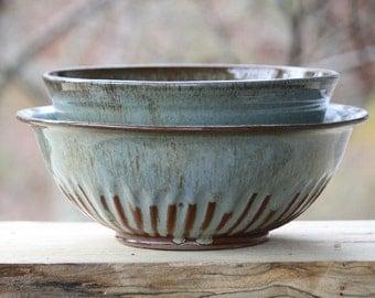 Set of ceramic fluted serving bowls. Stoneware fruit bowl and serving bowl