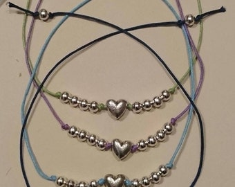 Handmade tie on anklet or bracelet with silver heart and silver beads. Set of four