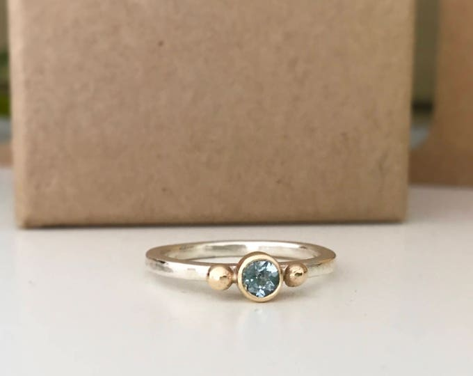 Aquamarine stacking ring in silver and 9ct yellow gold