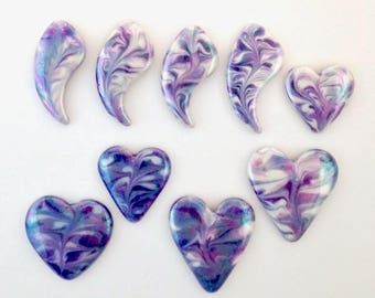 Porcelain cabochons with marbled designs hand painted in shades of purple.  Perfect focal components for your wire wrapping or bead work.