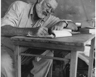 Ernest Hemingway Writing at Campsite in Kenya, 1953