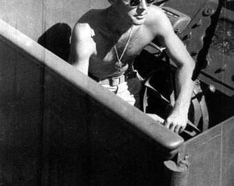 John F. Kennedy on his navy patrol boat, the PT-109, 1943, WWII JFK