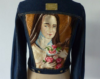 Jeans jacket with vintage tapissery a portrait of a Santa Teresa