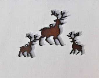 Reindeer charm and earrings set made out of rusted rustic rusty metal