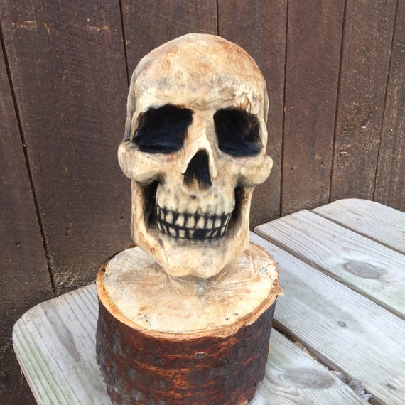 Skull chainsaw carving wood spooky sculpture