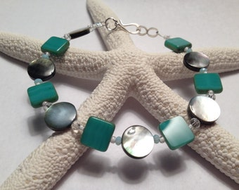 Shell Bracelet with Green Czech glass beads
