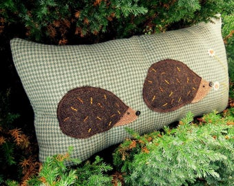 Hedgehogs.  A wool cushion with tweed hedgehogs.  57cm x 30cm.