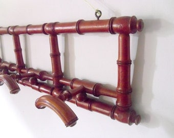 Antique coat rack French hat rack with retractable pegs Pine wood with dark red lacquer coat rack 4 adjustable pegs wall mounted early 1900s
