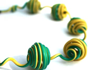 Upcycled jewelry. Yellow green necklace made of recycled electric cables HONGKONG