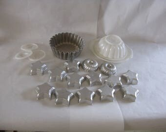 Lot of vintage jello molds metal plastic tupperware star round