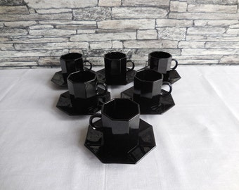 Vintage French black espresso coffee set, on the base of each cup &saucer is Esso collection