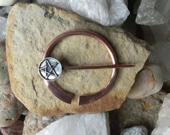 Copper pennanular brooch with sterling silver pentacle.