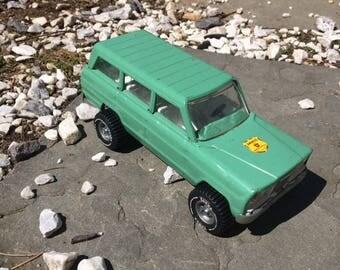 Vintage Tonka Jeep Wagoneer Smokey's Ranger Green Vehicle with Fold Down Tailgate Smokey the Bear Decal
