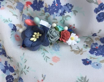 Small floral hair clip: Blue, white and coral flowers adorn this hair clip made to match Well Dressed Wolf's Sue Sue in Blue dress/Romper