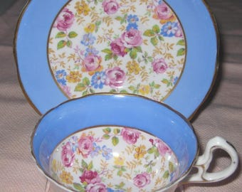 ROYAL STAFFORD English Cup and Saucer. Blue edge, chintz center