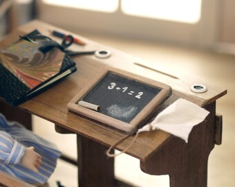 Small blackboard of wood desk for school, with chalk and eraser cloth.