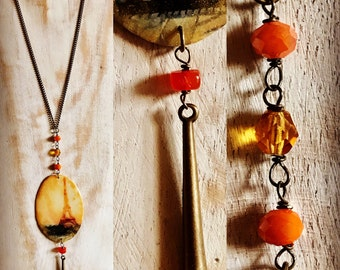 Antique brass long necklace Orange crystals and resin and brass charms