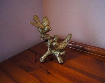 Vintage solid brass birds on a branch.
