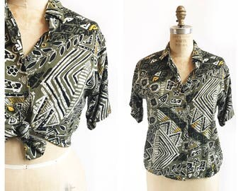 Olive and black abstract patterned button up blouse. Size S/M.