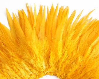Wholesale 1/2 Yard, Strung Rooster Golden Yellow Saddle Feathers (5-7 inches in length) for Crafting, Sewing, Wedding, Decoration SKU: 7A51