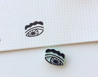 Single eye stamp. Rubber stamp. Hand carved