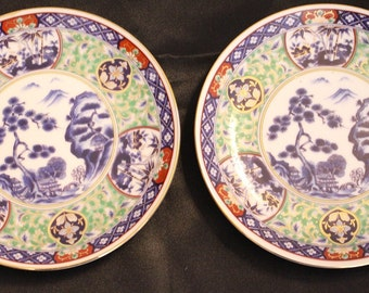 Two Beautiful Japanese Plates Decorated with trees and bamboo, homes red blue and green colors