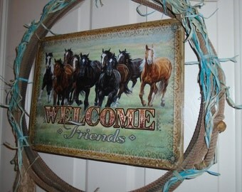 An Authentic rope used by team ropers, Painted raffia the color of blue to match Picture that is on tin.