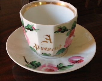 """Antique Large Cup and Saucer with Roses and """"A Present"""""""