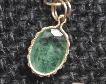 Simple emerald pendant in Gold filled fancy wrap