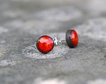 Lava red ceramic stud earrings.