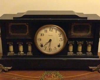 1910's Ingraham American time and strike clock (Adamantine on wood )