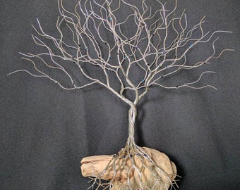 Fantastic looking wall hanging wire tree mounted to NW driftwood with Deep Blue beads is 15 inches tall 15 inches wide. Sculpture #170320