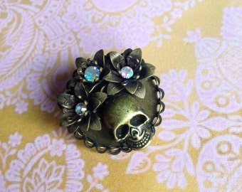Skull brooch flower human