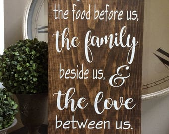 """Bless the food beforee us, the family beside us & the love between us. Amen  Ready to ship, measures approx. 23"""" tall x 11.25"""" wide"""
